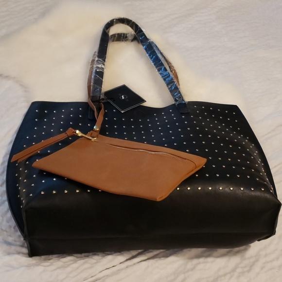 Under One Sky Handbags - Nwt reversible tote with wristlet black brown stud